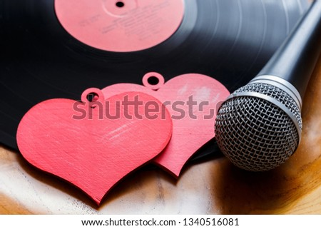 Song for lovers. Nostalgic songs, concept with vinyl records, microphone and hearts. #1340516081
