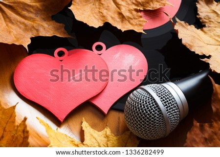 Song for lovers. Nostalgic songs, fallen leaves and melancholy. Concept with vinyl records, microphone and hearts. #1336282499