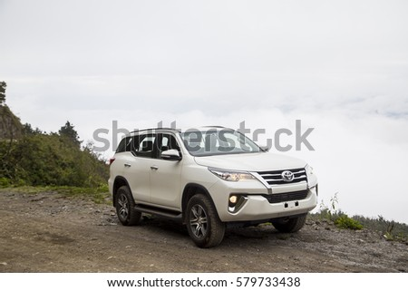 Sonla, Vietnam - Jan 21, 2017: Toyota Fortuner 2016 all new car on the mountain road in test drive, Vietnam. #579733438