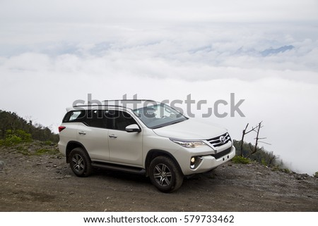 Sonla, Vietnam - Jan 21, 2017: Toyota Fortuner 2016 all new car on the mountain road in test drive, Vietnam. #579733462