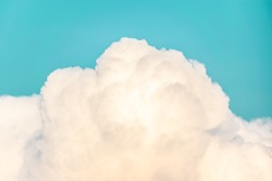 Soothing Orange-ish white clouds on light blue sky