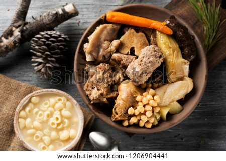 sopa de galets or escudella de Nadal, and carn d olla, soup with galets pasta and the meat and vegetables used in the broth, typically eaten on Christmas in Catalonia, Spain