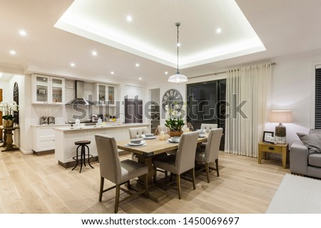 Sophisticated and modern style dining room combined with modular open kitchen decorated with exquisite furniture and furnishings. #1450069697