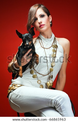 Sophisticated woman with her dogs