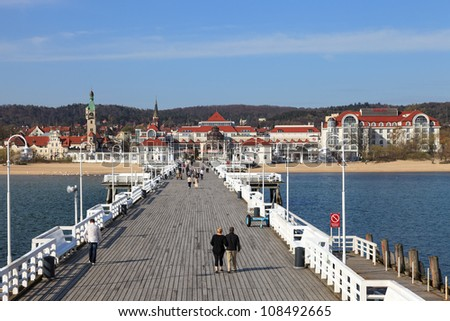 SOPOT, POLAND - APRIL 26, 2012: The Sopot Pier in the city of Sopot built in 1827. At 511m, the pier is the longest wooden pier in Europe. Pier life on April 26, 2012 in Sopot, Poland.