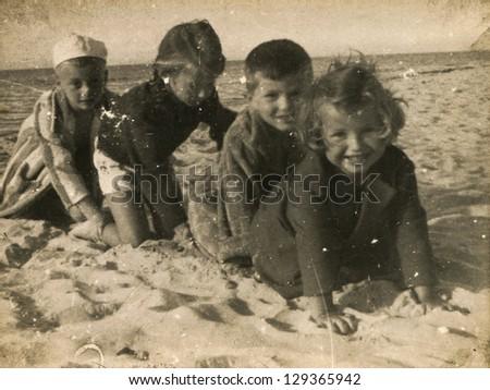 SOPOT, POLAND - CIRCA 1949: vintage photo of group of unidentified children playing on beach, circa 1949 in Sopot, Poland