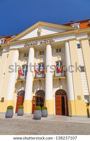 SOPOT, POLAND - MAY 06, 2013: Facade of Sofitel Grand Hotel on May 6, 2013 in Sopot. This five stars hotel was built in 1924 at the seaside of the Gdansk Bay, in the heart of old town and at the pier.