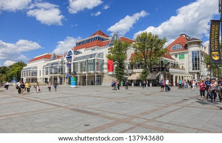 SOPOT, POLAND-MAY 6:People walking on May 6, 2012 in Sopot,Poland.City is a major health-spa and tourist resort.The city is famous for its Sopot Song Festival and has the longest wooden pier in Europe