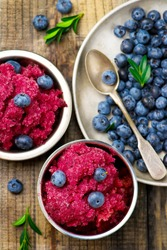 sorbet from bilberry in metal vases and fresh blueberry in a bowl. style vintage. selective focus