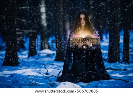 Sorceress celebrating the magic of the magic books #586709885