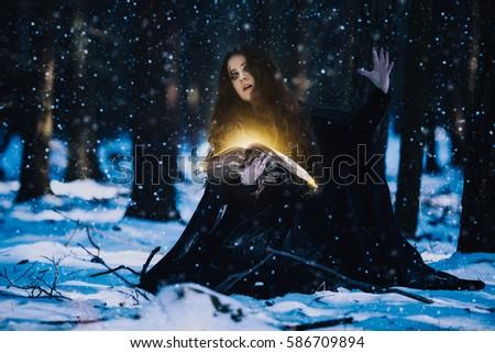 Stock Photo Sorceress celebrating the magic of the magic books