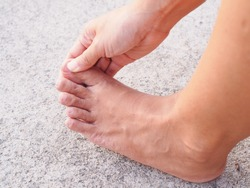 Sore feet with symptoms inflammation of foot nerve, Pain in toes and soles of feet, injured nails.