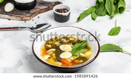 Sorrel soup with egg in bowl. Traditional Latvian soup. Skabenu zupa, Food recipe background. Close up, top view. Zdjęcia stock ©