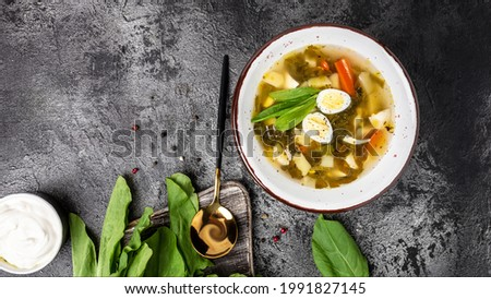 Sorrel soup with egg Traditional Latvian soup. Skabenu zupa, Food recipe background. Close up, top view, Zdjęcia stock ©