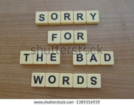 sorry for the bad words, word cube on wood background #1389356939