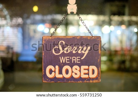 Sorry sign hang on mirror of shop #559731250