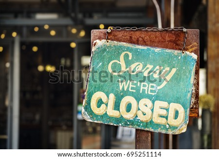 sorry we are closed sign hanging outside a restaurant, store, office or other #695251114