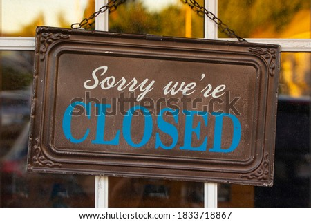 Sorry We're Closed Sign on a Sunny Autumn/Fall Evening. Covid19 Closure Concept Photo stock ©