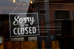 Sorry we're closed . vintage black and white retro sign on a coffee glass door