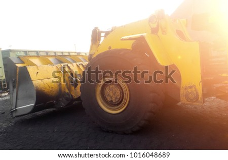 sorting of the breed. Mining coal. The bulldozer sorts the coal. Extractive industry, anthracite. Coal industry. Heap of coal ore with front loader