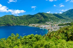 Soufriere Village - tropical coast on the Caribbean island of St. Lucia. It is a paradise destination with a white sand beach and turquoiuse sea.