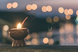 Soul and spirituality abstract concept  for mourning and world human spirit day with warm candle light bokeh illumination, golden sunset sky and reflective river wave background