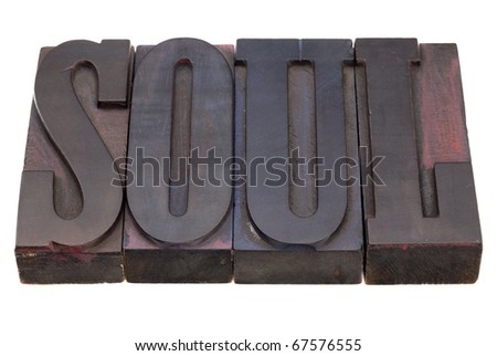 soul word in antique wooden letterpress printing blocks, stained by color inks, isolated on white
