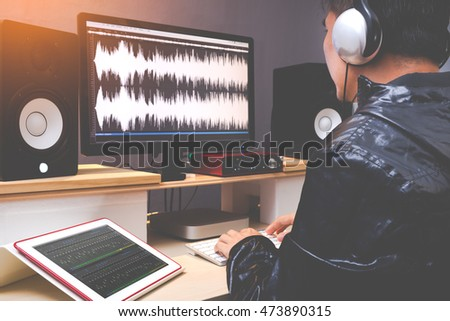 sound engineer, audio editor working in TV or radio broadcasting studio