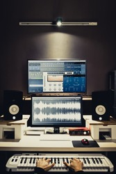 sound engineer, composer working in digital editing & recording studio for post production or broadcasting