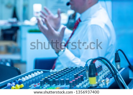 Sound engineering. Sound engineer at the mixing console. Digital mixing console. Sound equipment. Audio equipment. Sound recording.