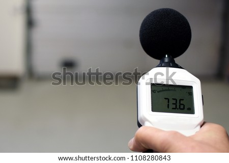 Sound level meter measuring the noise. Space for text. Stock photo ©