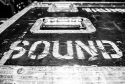 Sound logo on touring rack pop rock flight cases texture background