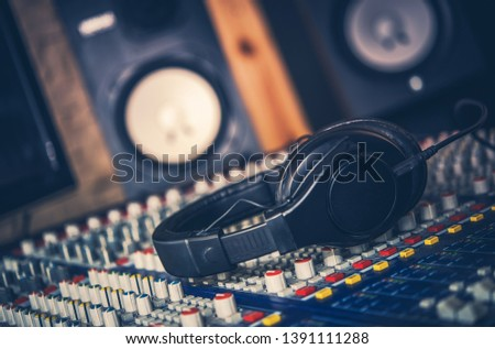 Sound Mastering Job. Audio Equipment in the Recording Studio. Professional Headphones and Audio Mixer. Modern Technology.
