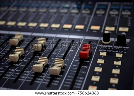 Sound mixer console is an electronic device for combining sounds, routing, and changing the volume level, timbre or dynamics of many different audio signals. #758624368