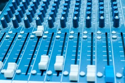 Sound mixer in studia in blue light. Control panel music.