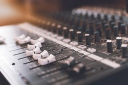 Sound mixer. Professional audio mixing console with lights, buttons, faders and sliders.