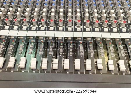 sound mixer selective focus. Large music mixer desk in recording studio