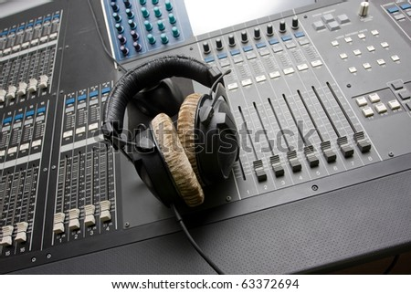 Sound mixing console with headphones