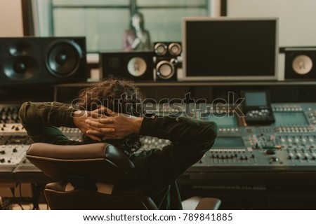 sound producer relaxing in armchair at recording studio #789841885