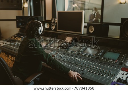 sound producer working at studio while recording song #789841858