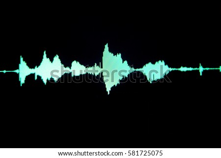 Sound recording studio audio wave on computer screen in professional editing program for voice, vocal, dj deejay musical mixing #581725075