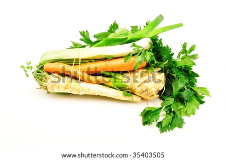 Soup green : carrots, celery, leek and parsley on white bacground