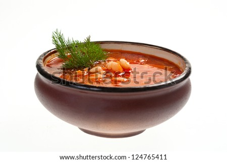 Soup in ceramic bowl on white background #124765411