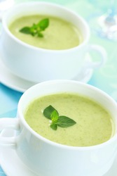Soup of green vegetables with fresh herbs