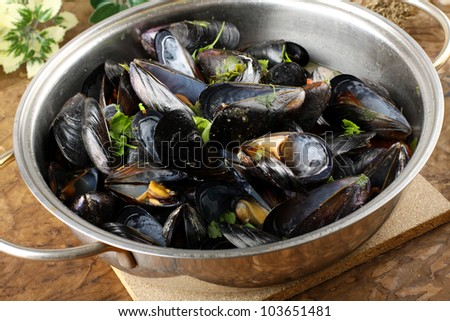 Soup of mussels in the pan