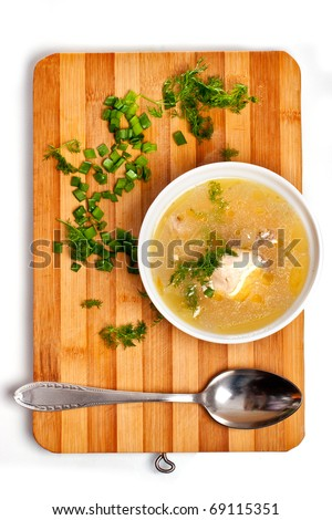 Soup plate on kitchen chopping board