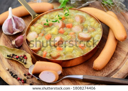 Soup, stew with sausage, peas and carrot, closeup.