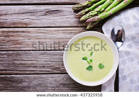 Soup with asparagus on wooden background with copy space Stock photo ©