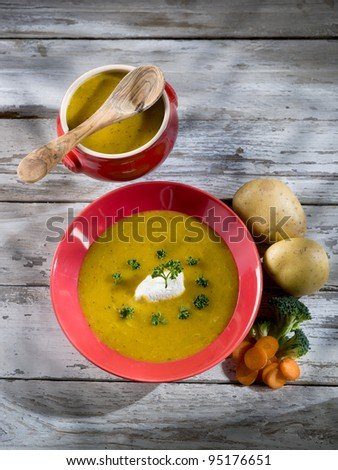 soup with carrots, broccoli, potato and sheep cheese
