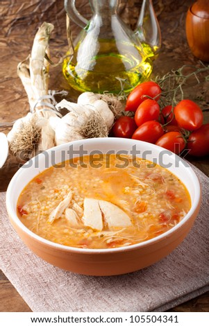 Soup with chicken broth on complex background